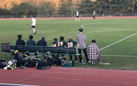 Jimmy McCloud ('22) sits out for a home soccer game.