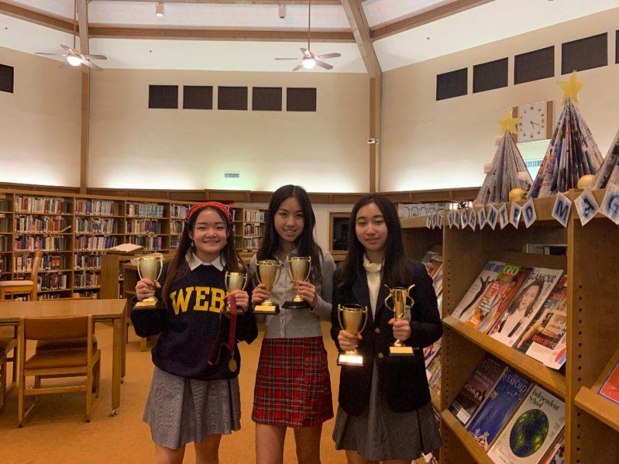Emily+Huang+%28%E2%80%9823%29%2C+Elaine+Shao+%28%E2%80%9821%29%2C+and+Angela+Xie+%28%E2%80%9821%29+pose+with+their+debate+awards.+