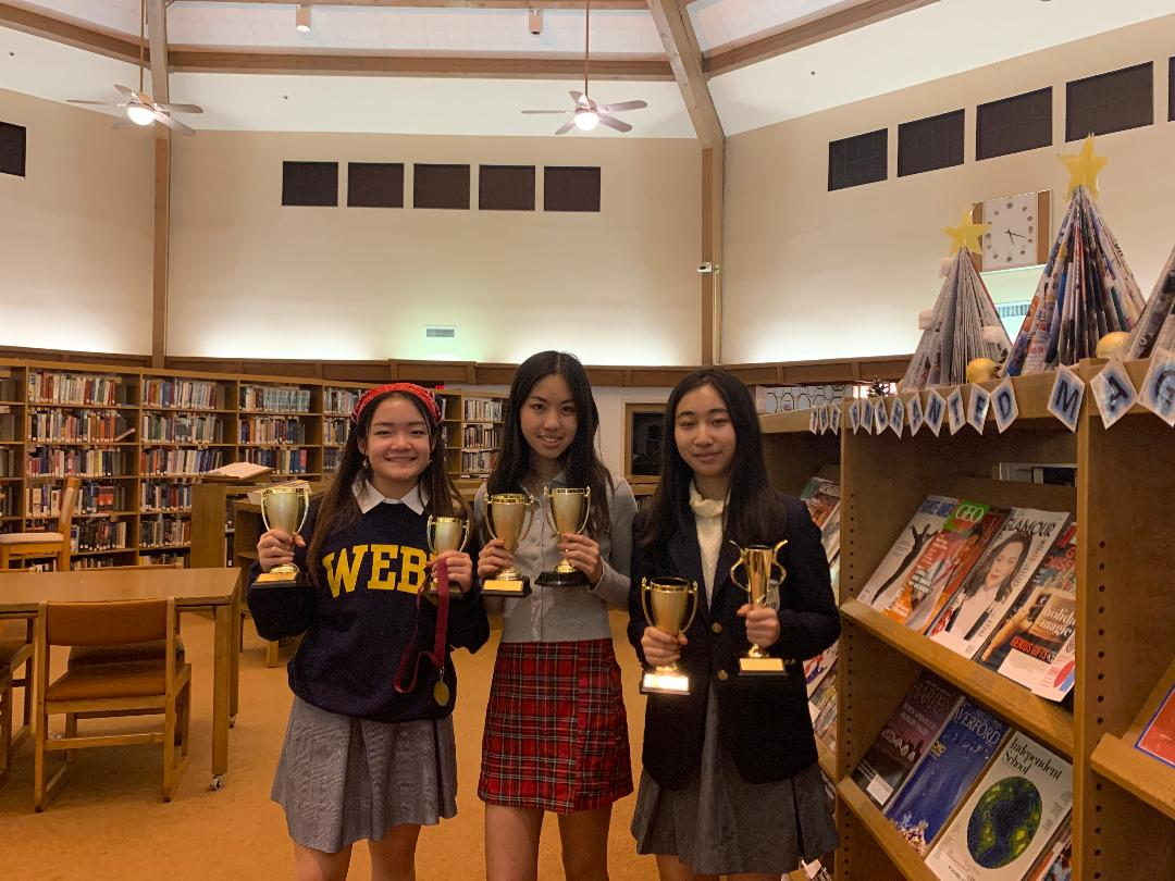 Emily Huang ('23), Elaine Shao ('21), and Angela Xie ('21) pose with their debate awards.