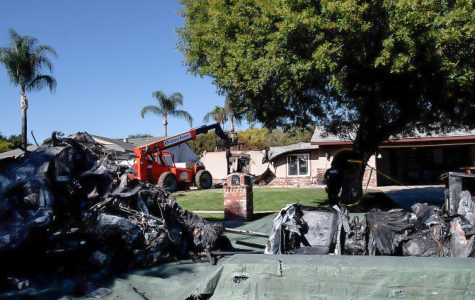 Firefighters remove remains of the plane crash from the Tonello's house. Graphic Courtesy of Daily Bulletin