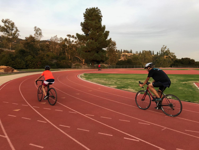 Triathletes race around Faculty Field.