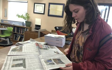 Eleanor Corbin ('20) reads through the newspaper that covers the impeachment of Donald Trump.