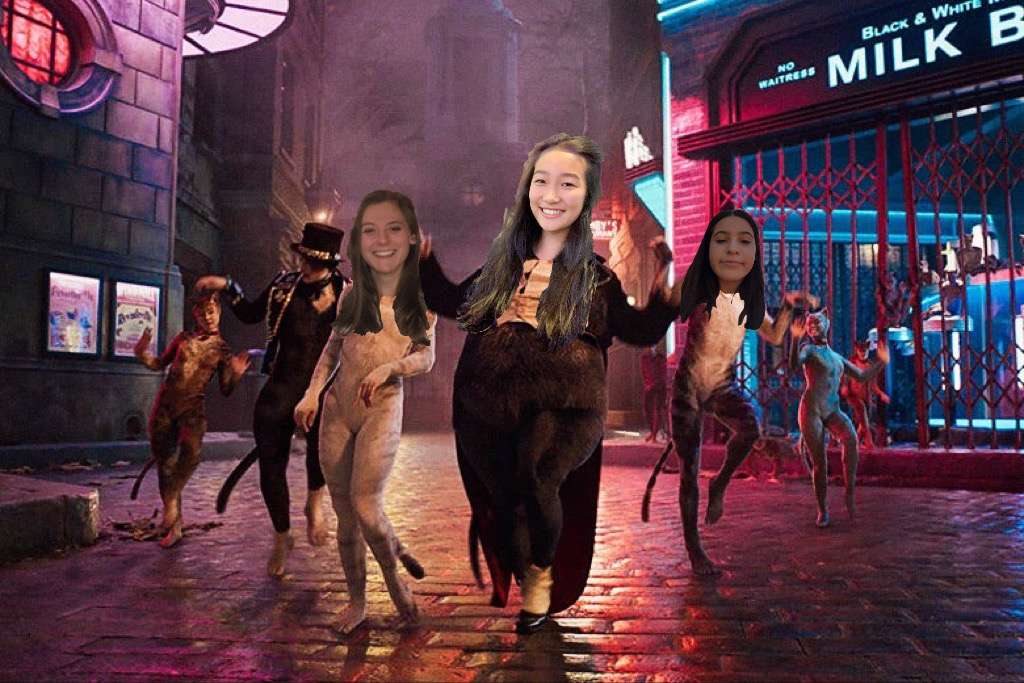 Senior members of the WCC staff pose as cats from the musical. Graphic courtesy of Janitza Luna