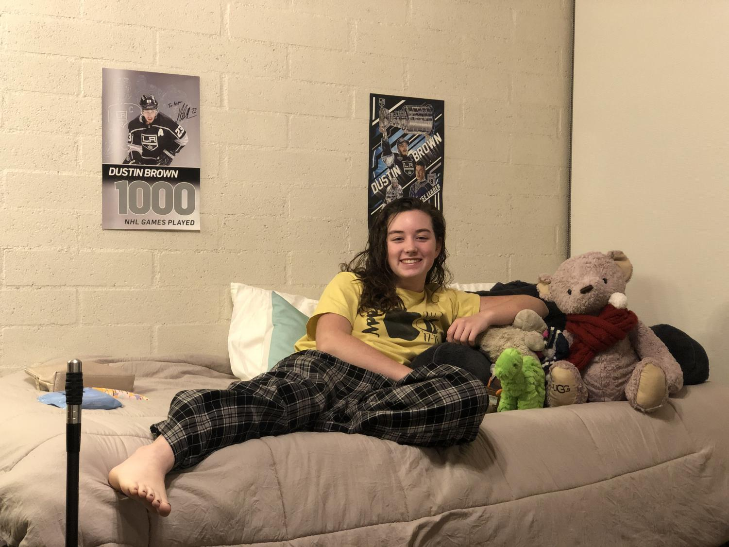Aspen Helgeson ('20) relaxes in her bed, enjoying the freedom of being a second semester senior.