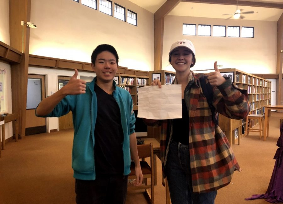 Jin Song ('21) and Jenna Hawkes ('21) pose for a picture with smiles and thumb-ups.