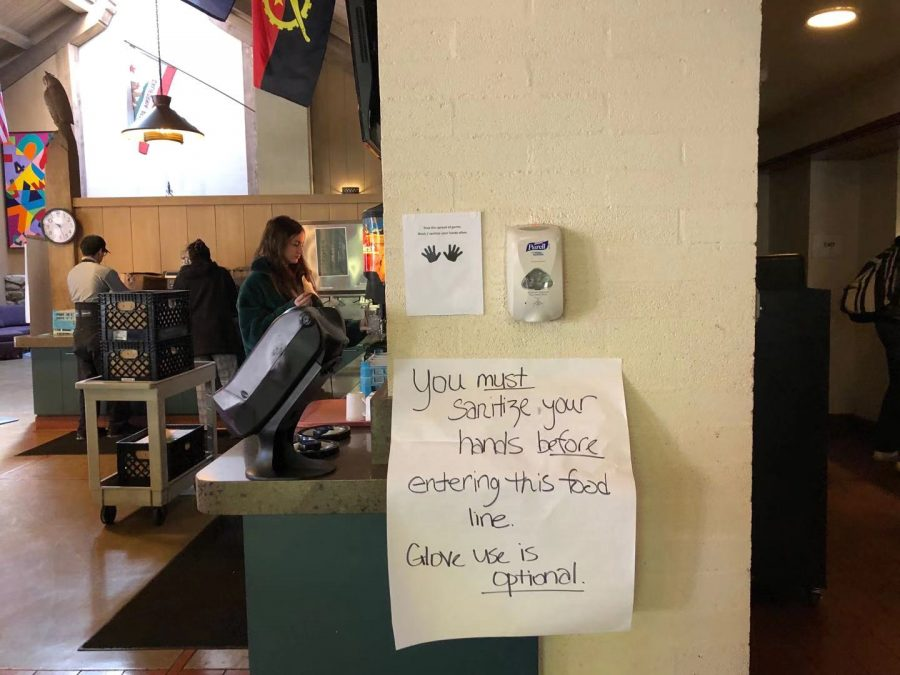 Notice in the dining hall reminds students to wash their hands before each meal to avoid infection.