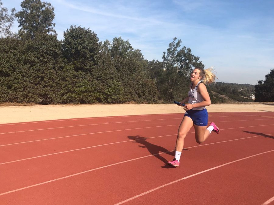 Dora sprints around Webb's track.