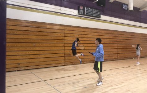 Jayden Chiu ('20) smashes a bird with his partner Eric Liu ('20) during warm-up.