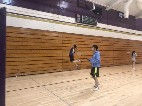 Jayden Chiu ('20) smashes a bird with his partner Eric Liu ('20) during warm-up.