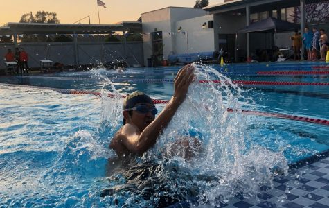 Charlie Sun ('22) turns during the 100 yard breaststroke.