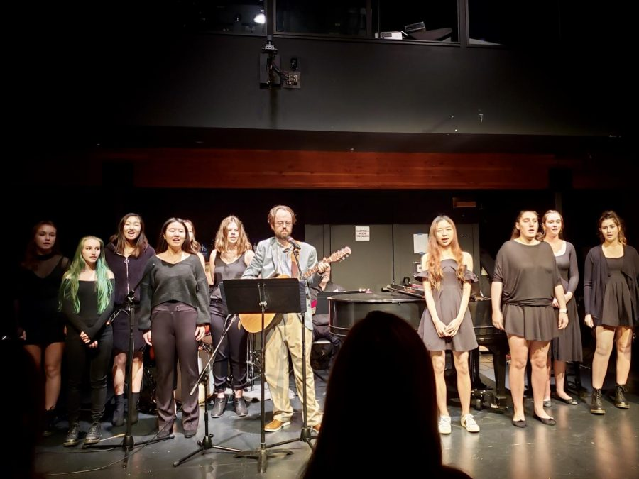 """The chamber singers kick off the night with """"Cherry Wine,"""" led by Sean Burns, fine arts department faculty."""