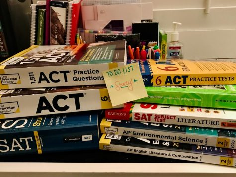 A pile of practice test books awaits.