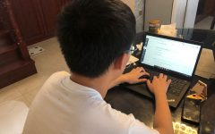 Jonathan Yu ('22) studies at home.