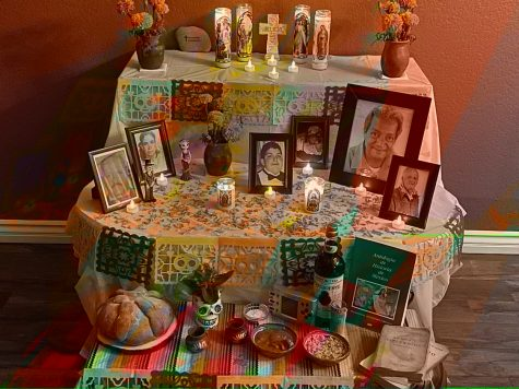 "Valeria Gonzalez ('23) celebrates Día de los Muertos with her colorful ""ofrenda,""altar in Spanish."