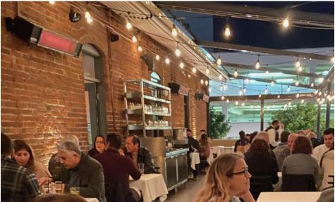 Café Santorini welcomes patrons to outdoor balcony area.