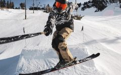 Snowboarder rides down Mammoth Mountain under COVID guidelines .