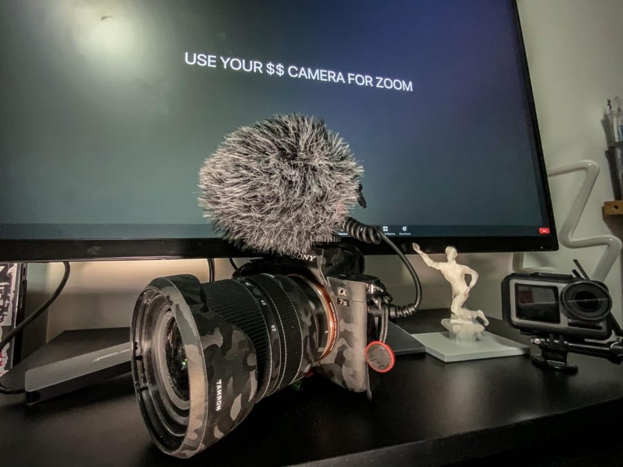 Connecting a camera to a computer for Zoom.