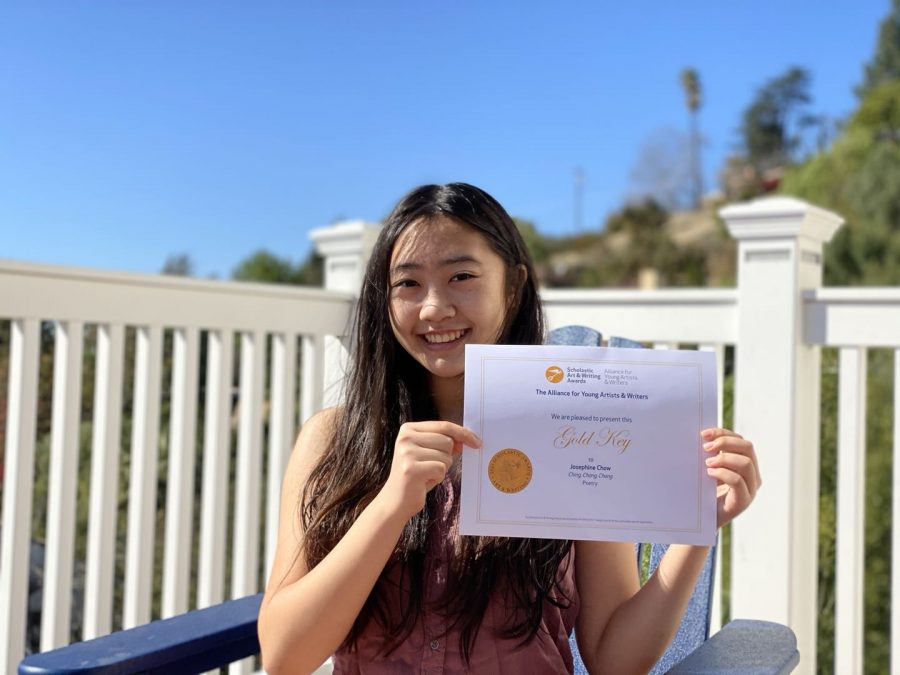 Josie Chow ('22) stands holding her Gold Key award.