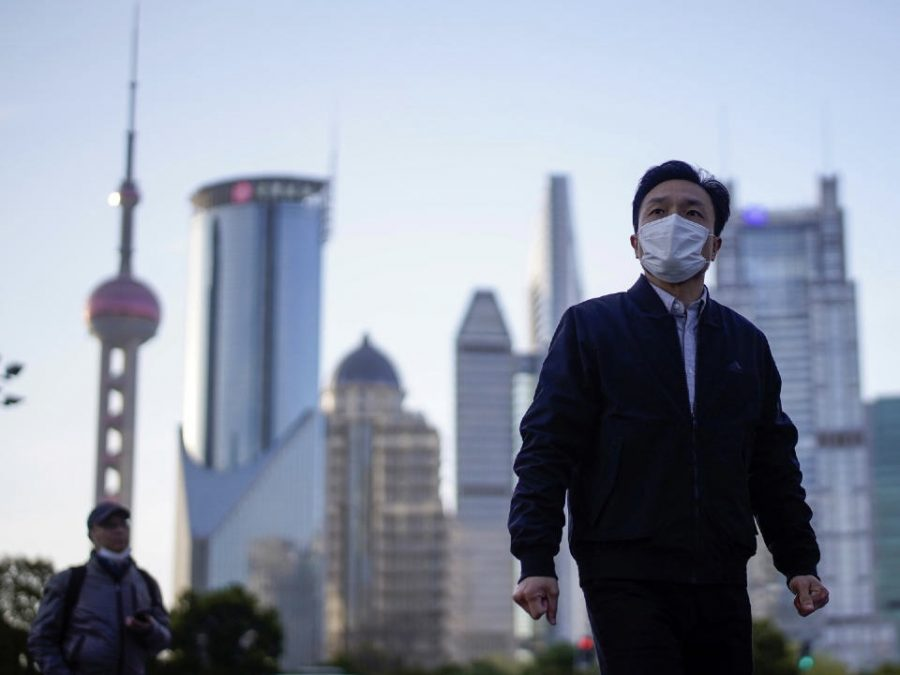 People wear face masks in Shanghai's Lujiazui District.