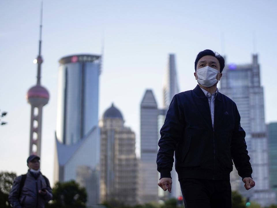 People wear face masks in Shanghai's Lujiazui District.
