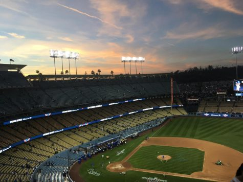 The sun sets over Dodger Stadium.