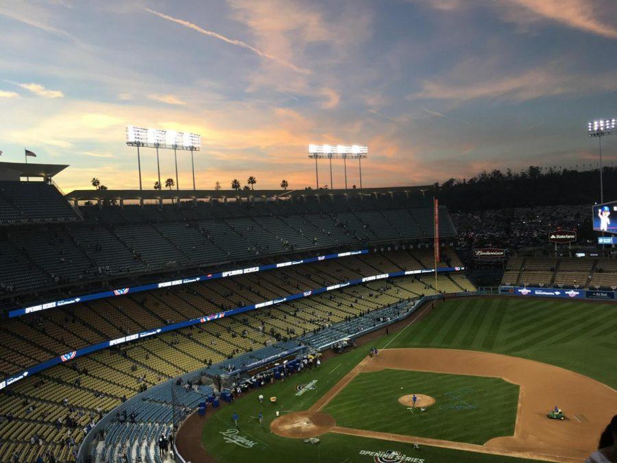 The sun sets over Dodger Stadium.