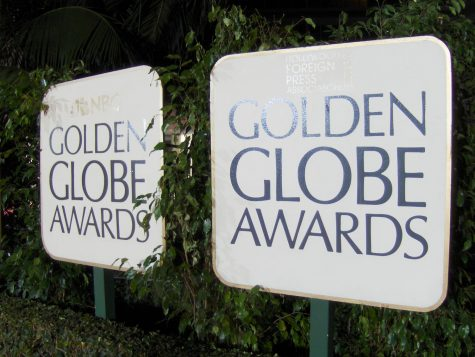 The Golden Globe Awards sign glows on its eventful night.