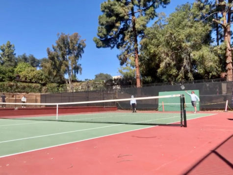 Jaydyn Akpengbe ('22) and Matthew Gooch ('22) practice tennis before afternoon activities.
