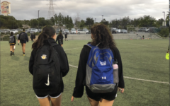 Eva Annabi ('23) and her friend walk together after club soccer practice.