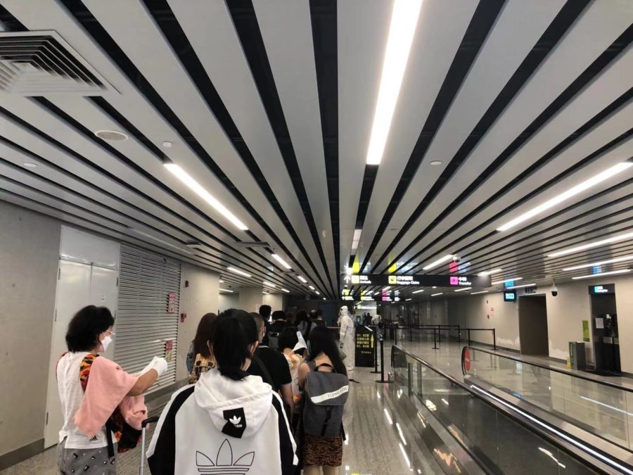 The Guangzhou Baiyun international airport transports another group of travelers to 14-day hotel quarantine.