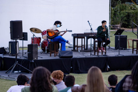 Xander Kong ('22) and Matthew Gaw ('21) preform on-stage together. This year, the stage was wide instead of deep to accommodate more people on stage with proper social distancing.