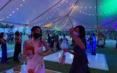 Emily Wang ('22) and Sharon Xu ('22) dance together.