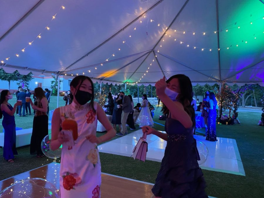 Emily Wang ('22) and Sharon Xu ('22) dance together.