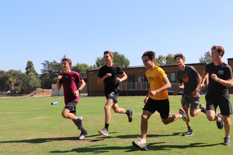 Garret Cordova Caddes ('23), Etienne Griffon ('23), Aidan Helgeson ('23), Matt Maschler ('24), and Nick Theobald ('22) run together in a warm-up to prepare for practice.
