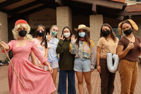 Arielle Brosh, humanities department faculty, Sharon Xu ('22), Nichola Monroe ('22), Angela An ('22), Cathy Wang ('22), Isabella Llorens ('22), and Madeline Lilley ('22) pose as the cast of Toy Story in front of Fawcett Library.