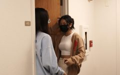 Britney Lu ('23) and Jolina Zhao ('23) stand in the doorway chatting before study hours start.  Credit: Sharon Xu (22)